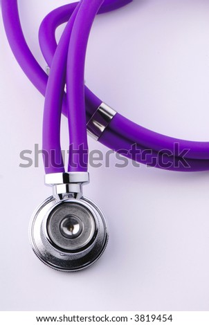 medical stethoscope lays on  surface of  table - stock photo