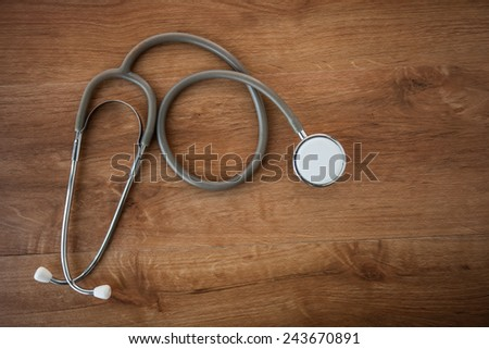 Medical Stethoscope on a wooden background - stock photo