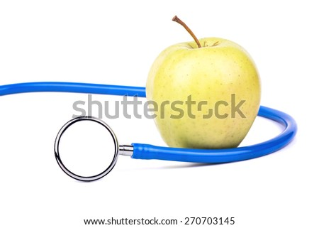 Medical stethoscope to listen to the heart and lungs with green apple