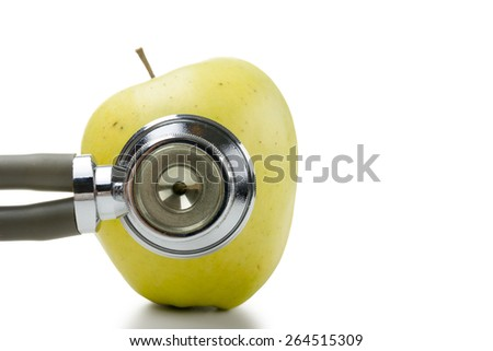 Medical stethoscope with green apple isolated on white background. Concept for diet, healthcare, nutrition or medical insurance - stock photo