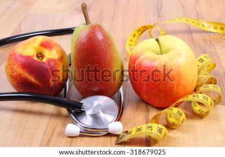 Medical stethoscope with tape measure and fresh fruits, concept of health care, healthy lifestyles and nutrition