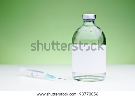 Medical still-life with a syringe and a drug vial with blank space - stock photo