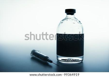 Medical still-life with a syringe and a drug vial with blank space