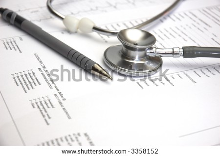 Medical still life with Hospital admission paperwork and a Doctor's stethoscope. - stock photo