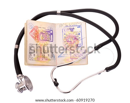 Medical still life with stethoscope and passport. Isolated. - stock photo
