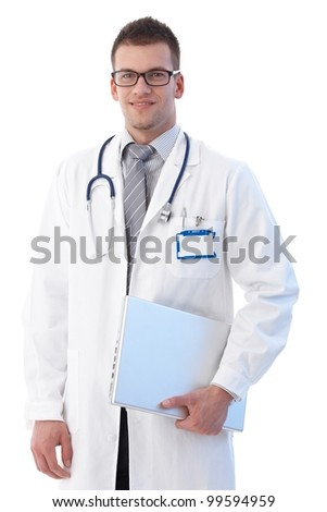 Medical student standing with laptop in hand, smiling. - stock photo