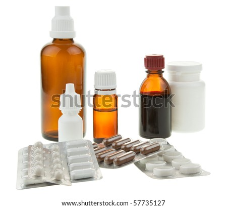 Medical supplies - vial bottles and pills on white background