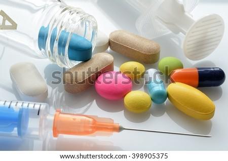 Medical syringe and medicine - stock photo
