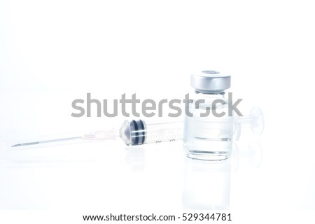 Medical syringe with medicine pill and vials, isolated on white background.