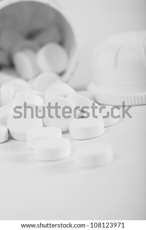 Medical tablets close up from the bottle - stock photo