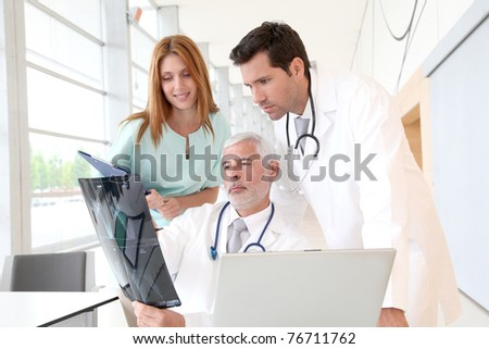 Medical team checking Xray