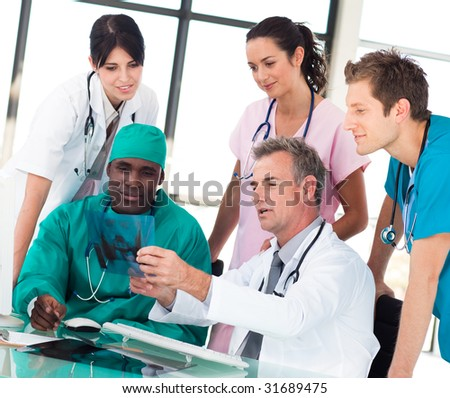 Medical team discussing in an office in a hospital - stock photo