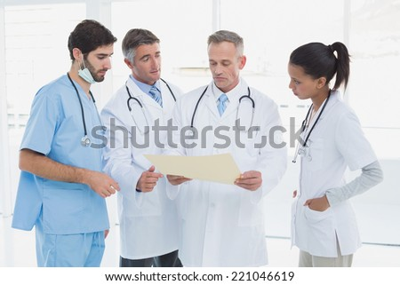 Medical team discussing some results in an office - stock photo