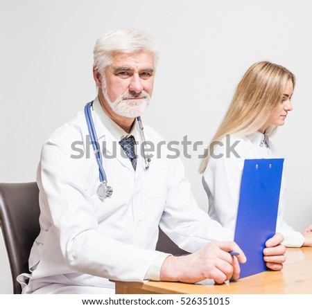 medical team doctors table room notebook
