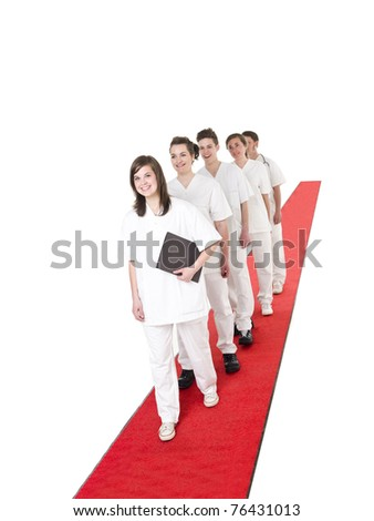Medical Team on a red Carpet isolated on white background - stock photo