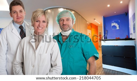 Medical team smiling at the reception of a clinic - stock photo