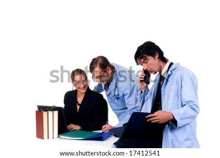Medical team, two young male cardiologist and female assistant in the office.  Studio, white background.
