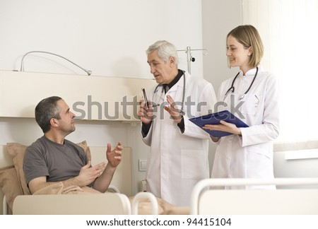 Medical team with a patient in the hospital - stock photo