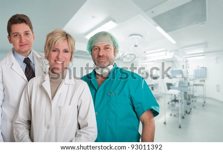 Medical team, with surgeon, anesthetist and nurse in an operating room - stock photo