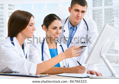 Medical team working in hospital - stock photo