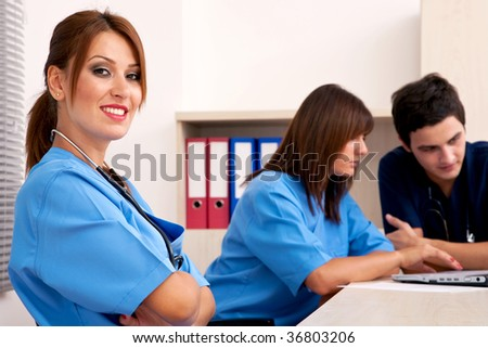 medical teamwork concept with a team of doctors with laptop - stock photo