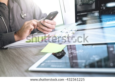 Medical technology network concept. Doctor hand working with smart phone modern digital tablet and laptop computer with medical chart interface, Sun flare effect photo  - stock photo
