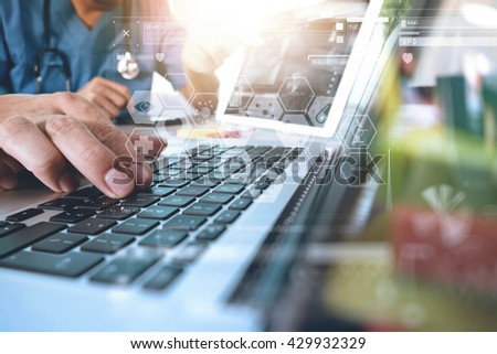 Medical technology network team concept. Doctor hand working with smart phone modern digital tablet and laptop computer with medical chart interface, Sun flare effect photo - stock photo