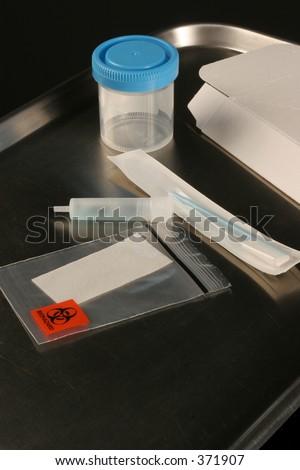 medical test kits for urine and saliva specimens - stock photo
