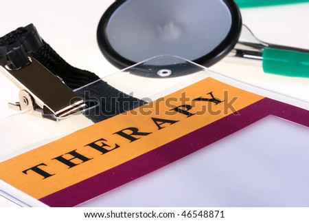 Medical theme - a badge of the doctor of the therapist and a stethoscope. - stock photo