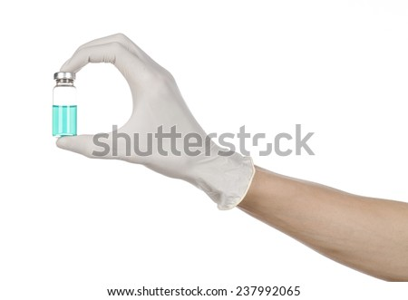 Medical theme: doctor's hand in a white glove holding a blue vial of liquid for injection isolated on white background - stock photo