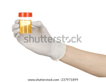 Medical theme: doctor's hand in white gloves holding a transparent container with the analysis of urine on a white background - stock photo