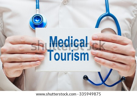 Medical Tourism. Practitioner showing information - stock photo