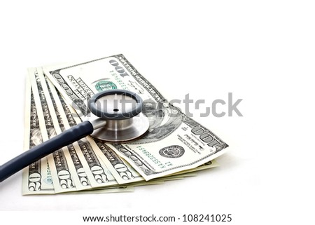 medical treatment and cost concept: stethoscope placing on US dollar banknotes on white background - stock photo