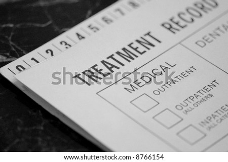 Medical Treatment Record on Exam Table