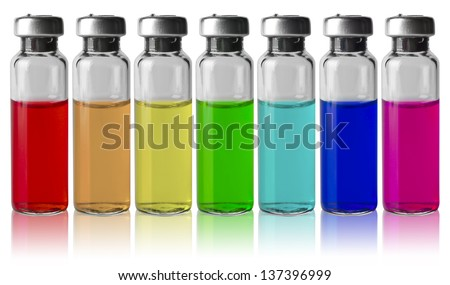 Medical vials in a row by color spectrum - stock photo