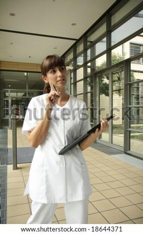 Medical woman nurse in medical hospital - stock photo
