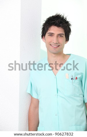 Medical worker in scrubs - stock photo