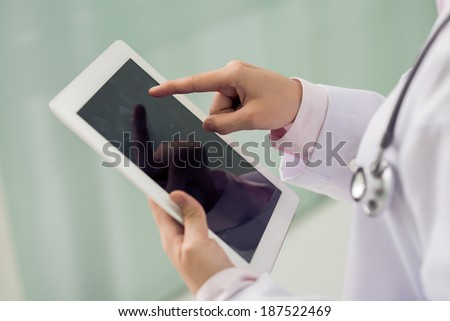 Medical worker using his pad - stock photo