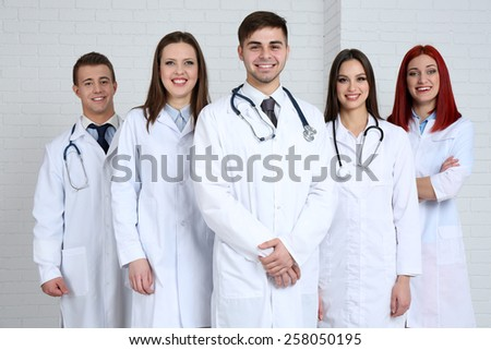 Medical workers in hospital - stock photo
