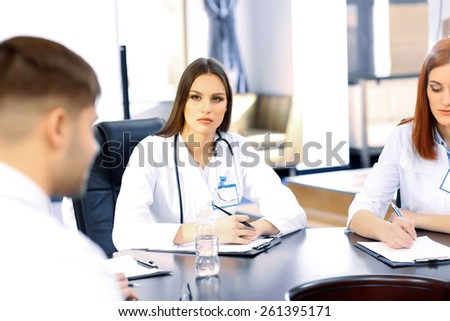 Medical workers working in conference room - stock photo