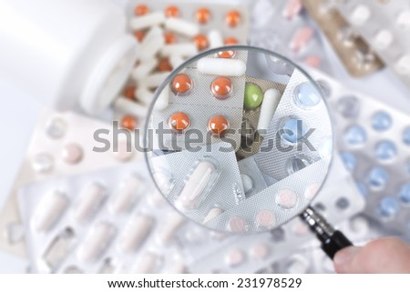 Medicaments under magnifying glass