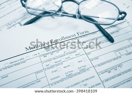 Medicare enrollment form and glasses