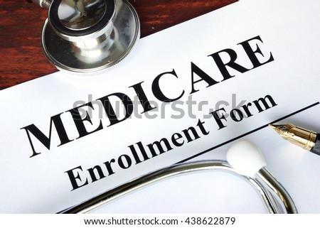 Medicare enrollment form written on a paper.   - stock photo