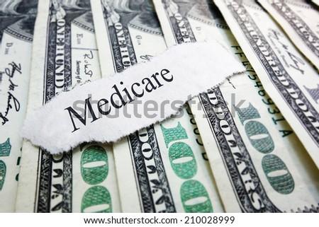 Medicare newspaper headline on assorted money                                - stock photo