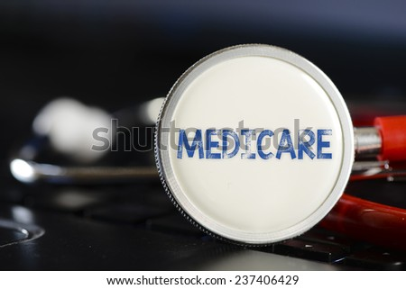 Medicare sign and stethoscope. Medicare sign and stethoscope. Medicine concept on computer keyboards - stock photo
