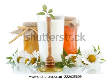 medicated milk with honey on white background - stock photo