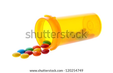 Medication color pills in pills bottle isolated on white background - stock photo