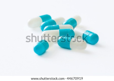 medication pills laying over white background