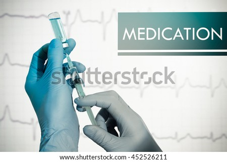 Medication. Syringe is filled with injection - stock photo