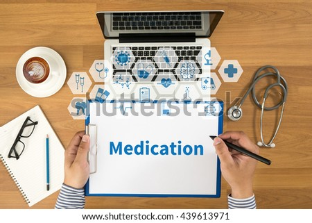 Medication Top view, Doctor writing medical records on a clipboard, medical equipment - stock photo